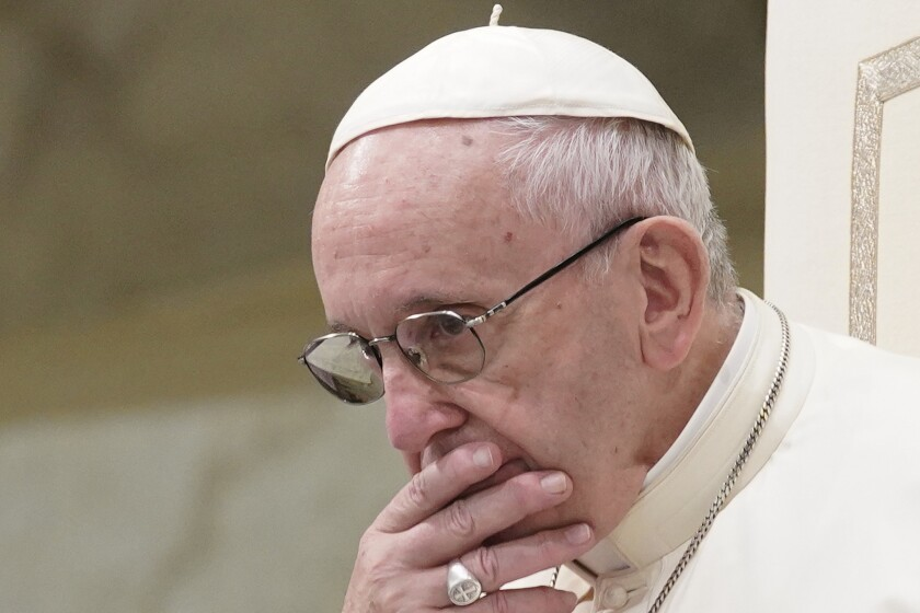 In this Aug. 22, 2018 file photo, Pope Francis is caught in pensive mood during his weekly general audience at the Vatican. Francis' papacy has been thrown into crisis by accusations that he covered-up sexual misconduct by ex-Cardinal Theodore McCarrick.