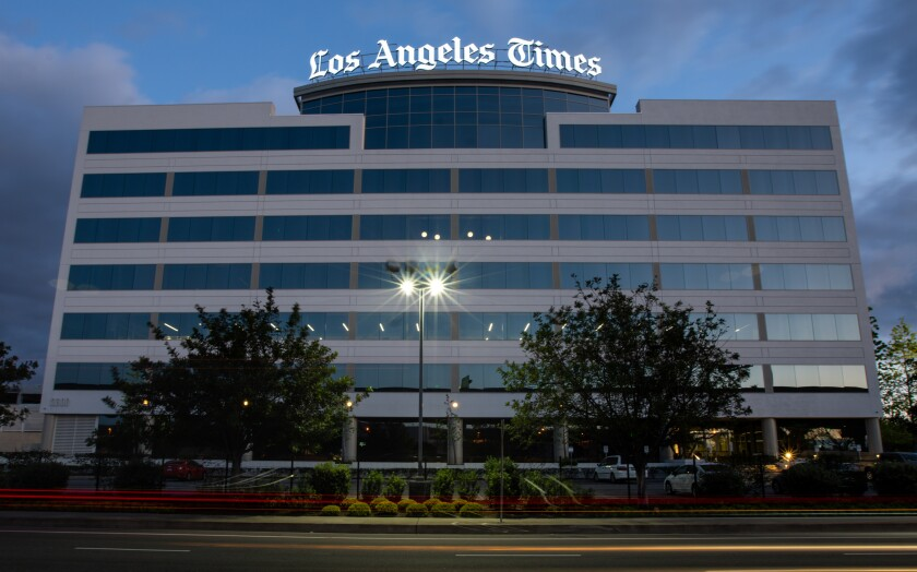 The Los Angeles Times logo atop a building.