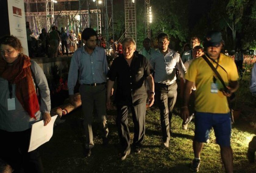 Zubin Mehta walks around the historic Shalimar Mughal Garden in Srinagar, the site of his planned peace concert in the Indian-controlled portion of Kashmir