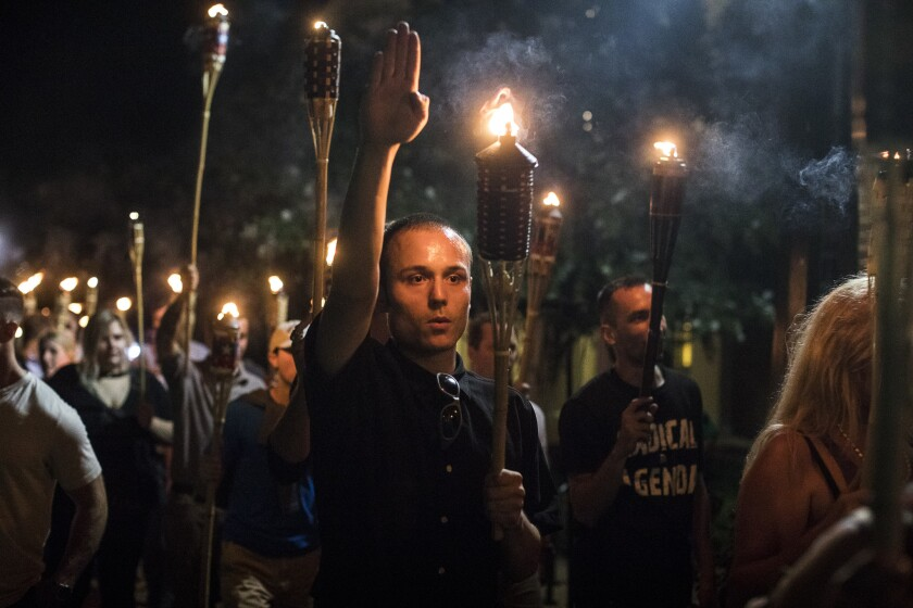 Torch-bearing white nationalists rally near the University of Virginia campus in Charlottesville, Aug. 11, 2017.