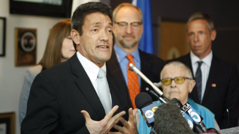 A former West Hollywood City Council deputy has accused the city of firing her for being a whistleblower about alleged sexual harassment by Councilman John Duran, pictured here in a 2012 press conference.