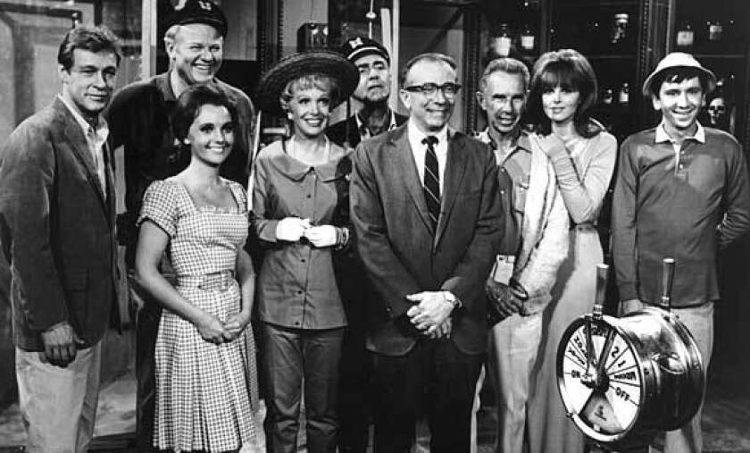 """""""Gilligan's Island"""" creator Sherwood Schwartz, center wearing a tie, with director Jack Arnold and the cast of the television show."""