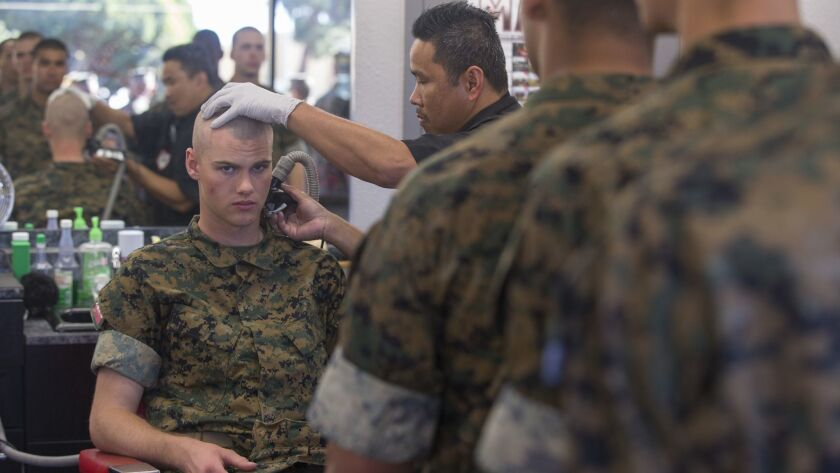 Recruits from Delta Company, 1st Recruit Training Battalion, receive haircuts at Marine Corps Recruit Depot San Diego on Tuesday.