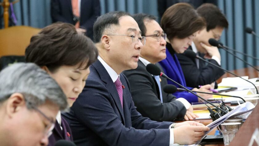 South Korean Finance Minister Hong Nam-ki, third from left, makes remarks at a meeting on reviving the economy at the government complex in Seoul on Jan. 9, 2019.