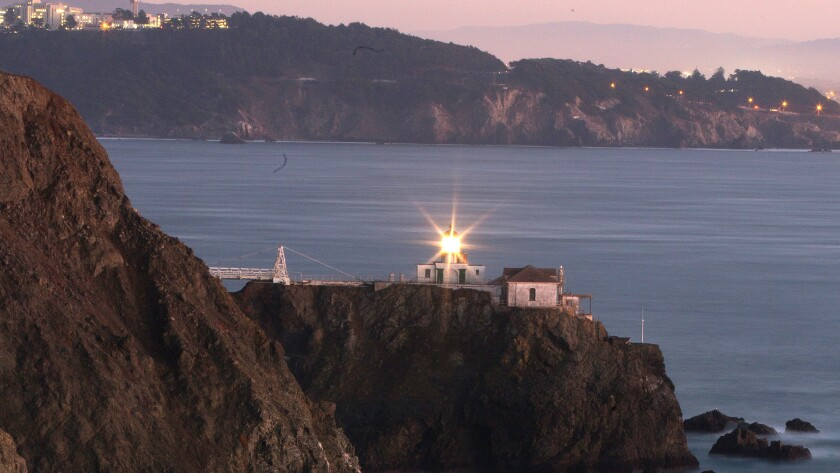 Dusk settles along the Marin Headlands and the Point Bonita Lighthouse in the Golden Gate National Recreation Area.