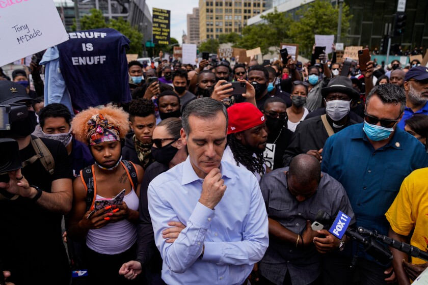 Los Angeles Mayor Eric Garcetti stands with demonstrators during a peaceful protest this month outside City Hall.