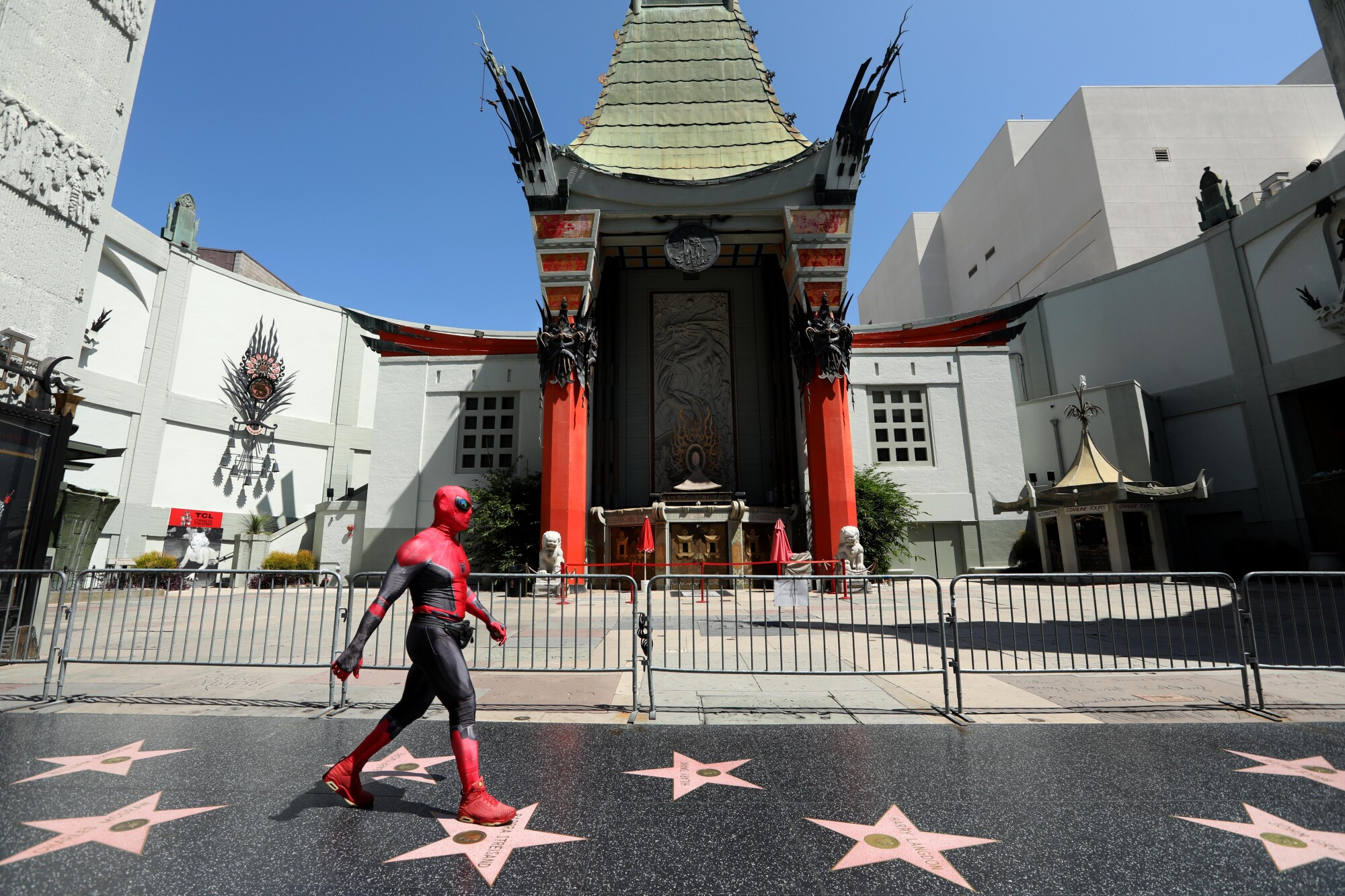A street performer dressed as Spider-Man on a deserted section of Hollywood's Walk of Fame on July 28, 2020.