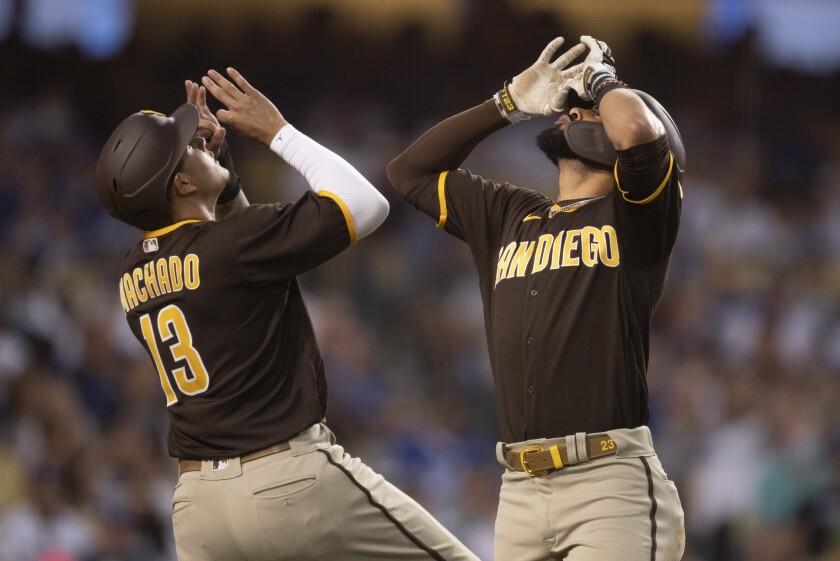 Fernando Tatis Jr. and Manny Machado celebrate Tatis' two-run homer at Dodger Stadium