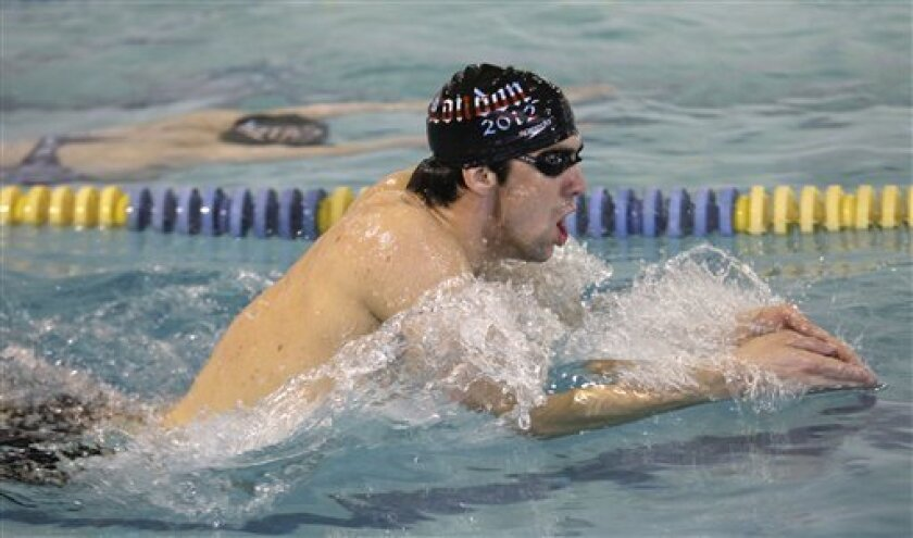 Olympic gold medalist Michael Phelps trains at the Meadowbrook Aquatic Center, Thursday, Feb. 5, 2009, in Baltimore. (AP Photo/Rob Carr)
