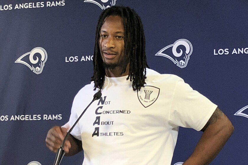 "Rams running back Todd Gurley wears a shirt reading ""Not Concerned About Athletes"" to his weekly news conference at the team's training complex in Thousand Oaks on Thursday."