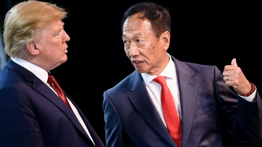 President Trump tours a Foxconn facility in Mount Pleasant, Wis., with Foxconn Chairman Terry Gou on June 28, 2018.