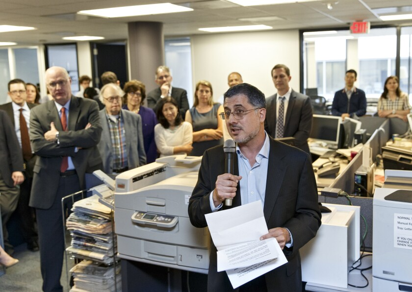 The Washington Post and the Guardian won Pulitzer Prizes for public service Monday for articles revealing the scope of surveillance by the National Security Agency. Above, writer Barton Gellman speaking in the Post's newsroom about the series after the prizes were announced.