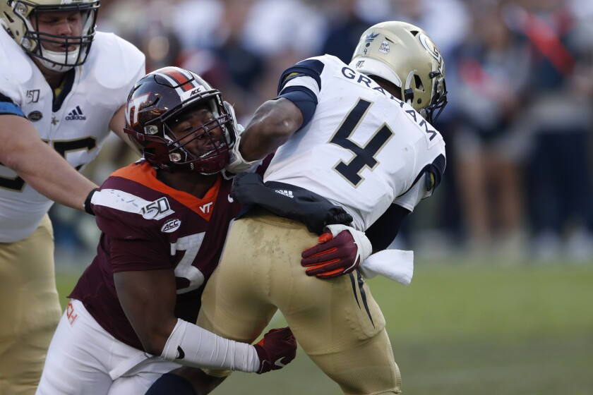 Georgia Tech quarterback James Graham (4) is sacked by Virginia Tech defensive lineman DaShawn Crawford (36) in the first half of an NCAA football game Saturday, Nov. 16, 2019, in Atlanta. (AP Photo/John Bazemore)