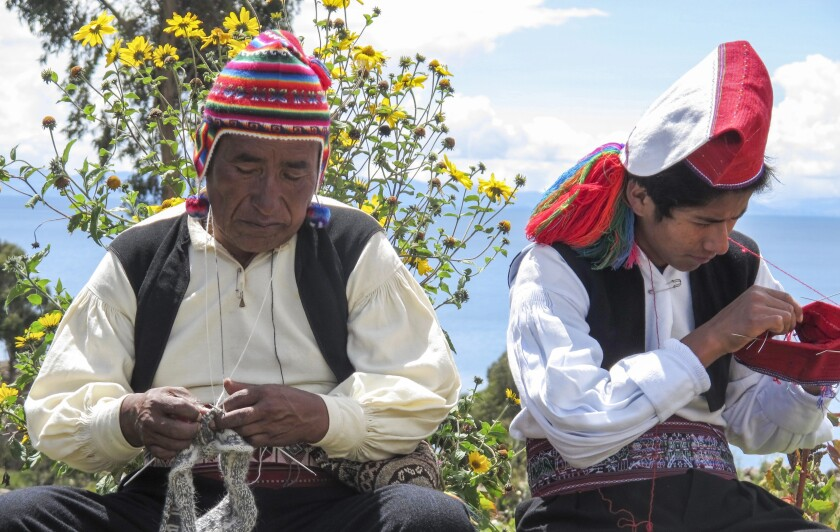On Taquile Island, the women weave and the men knit. They sell their work to visitors who pass through the scattered home sites on the island, a favored destination for travelers to Lake Titicaca.