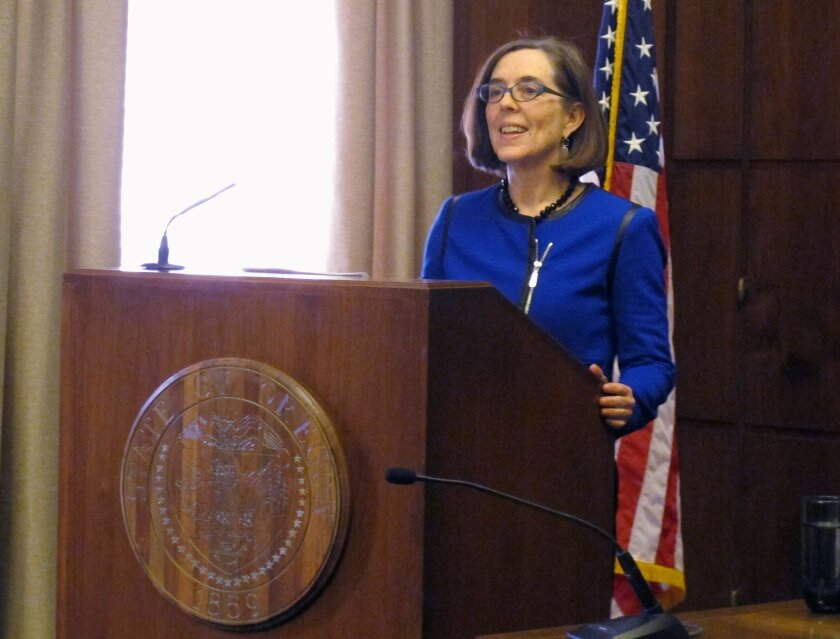 Oregon Gov. Kate Brown speaks to reporters at the state Capitol in Salem, Oregon on Friday, Feb. 20, 2015. In her first press conference since she became governor this week, Brown said she'd continue her predecessor's moratorium on the death penalty. (AP Photo/Jonathan J. Cooper)