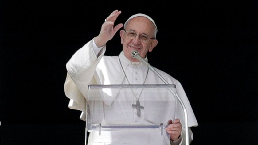 Pope Francis, shown waving to people in St. Peter's Square, has said he might be open to married men serving as priests to help relieve a shortage of priests in some regions.
