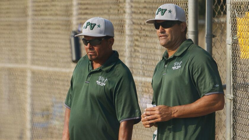 Park View manager Will Bleisch, right, and first base coach Jorge Alonso watch their players during Park View's game against Chula Vista American.
