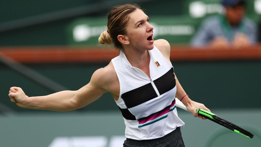 Simona Halep celebrates her victory over Kateryna Kozlova at the BNP Paribas Open at the Indian Wells Tennis Garden.