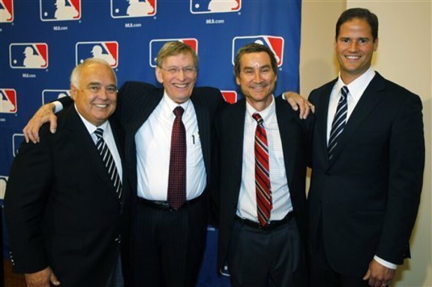 Members of a group approved to buy the San Diego Padres, from left, Ron Fowler, Peter Seidler and Kevin O'Malley.