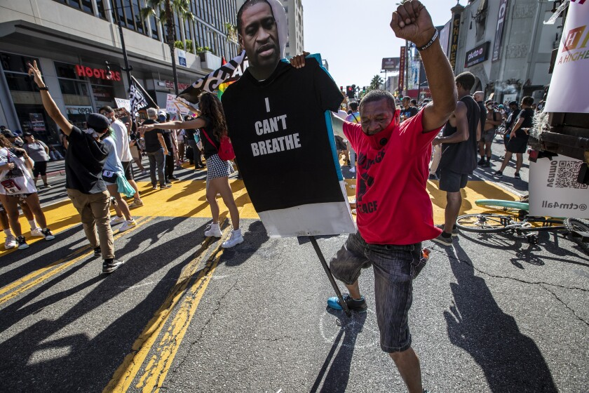 Pedro Chavez dances on Hollywood Blvd with numerous demonstrators as George Floyd protests continue in Hollywood.