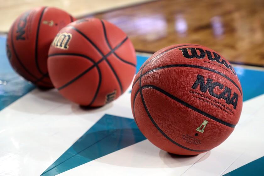 Basketballs on a court.