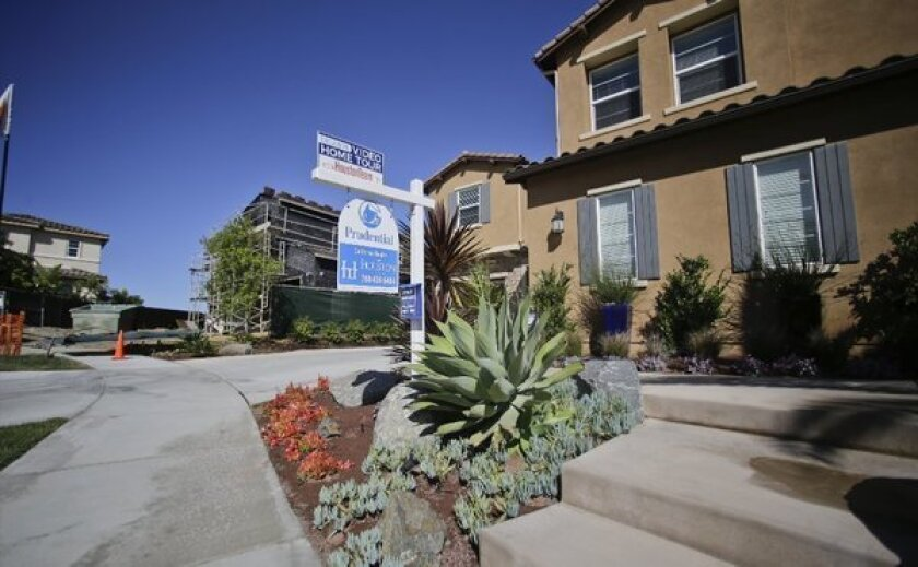 Mortgage rates remain low, spurring buying interest. Above, a house for sale in Carlsbad, Calif.