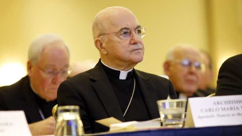 Archbishop Carlo Maria Vigano listens to remarks at the U.S. Conference of Catholic Bishops' annual fall meeting in 2015 in Baltimore.