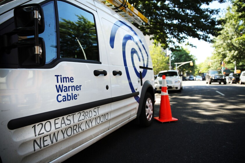 The Federal Communications Commission on Wednesday temporarily halted its review of Comcast's proposed purchase of Time Warner Cable.