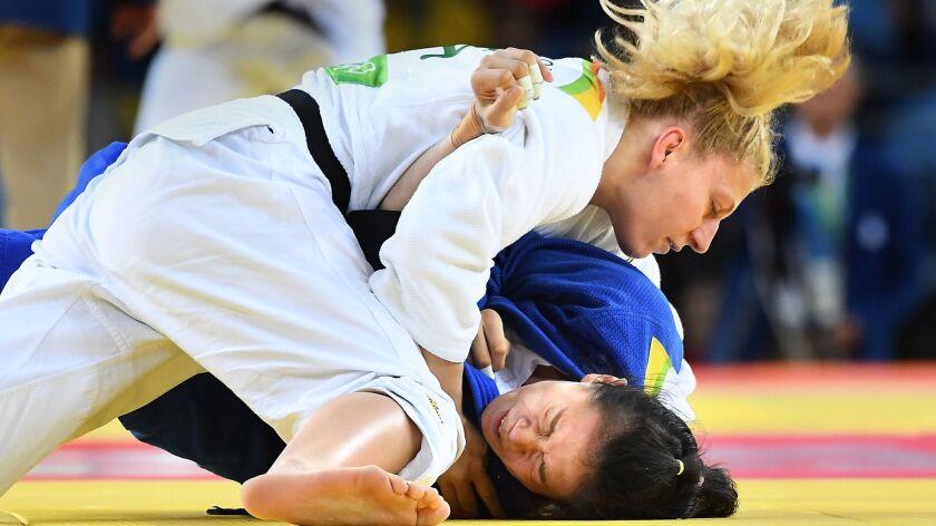 RIO DE JANEIRO, BRAZIL AUGUST 11, 2016-U.S. judo competitor Kayla Harrison takes down China's Zhehui