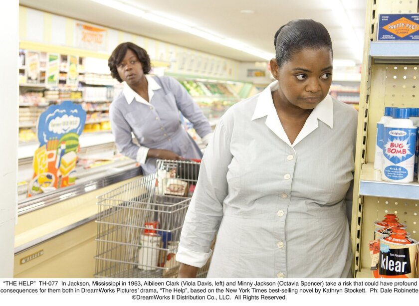 "In Jackson, Mississippi in 1963, Aibileen Clark (Viola Davis, left) and Minny Jackson (Octavia Spencer) take a risk that could have profound consequences for them both in ""The Help"", based on the New York Times best-selling novel by Kathryn Stockett. Photo: Dale Robinette/DreamWorks"