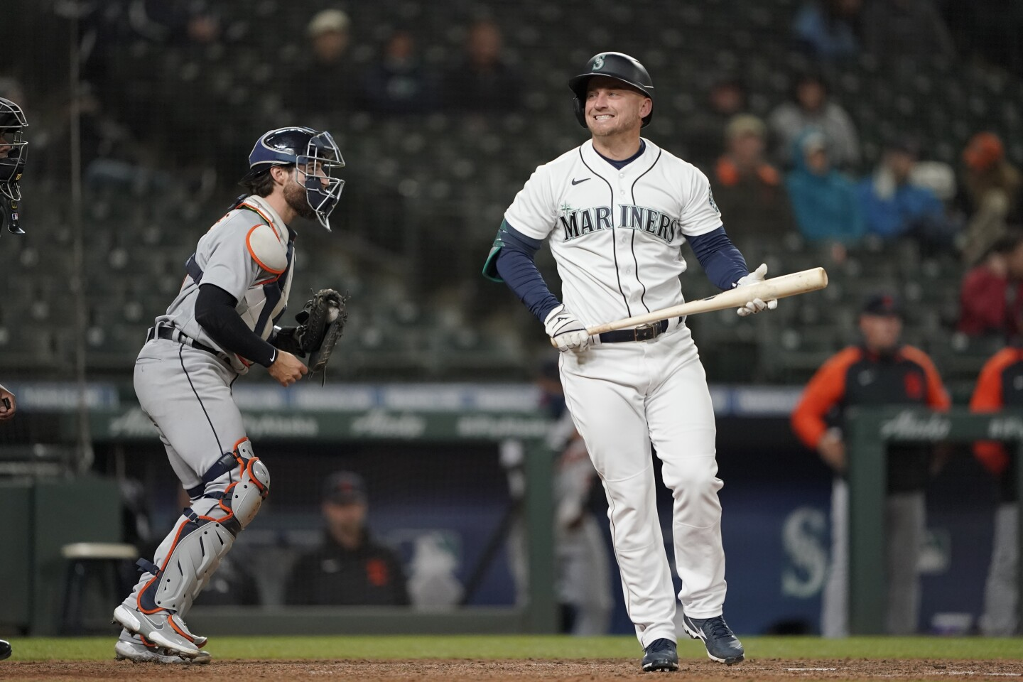 Seattle Mariners' Kyle Seager, right, reacts after striking out swinging with two men on base as Detroit Tigers catcher Eric Haase, left holds the ball during the eighth inning of a baseball game Wednesday, May 19, 2021, in Seattle. (AP Photo/Ted S. Warren)