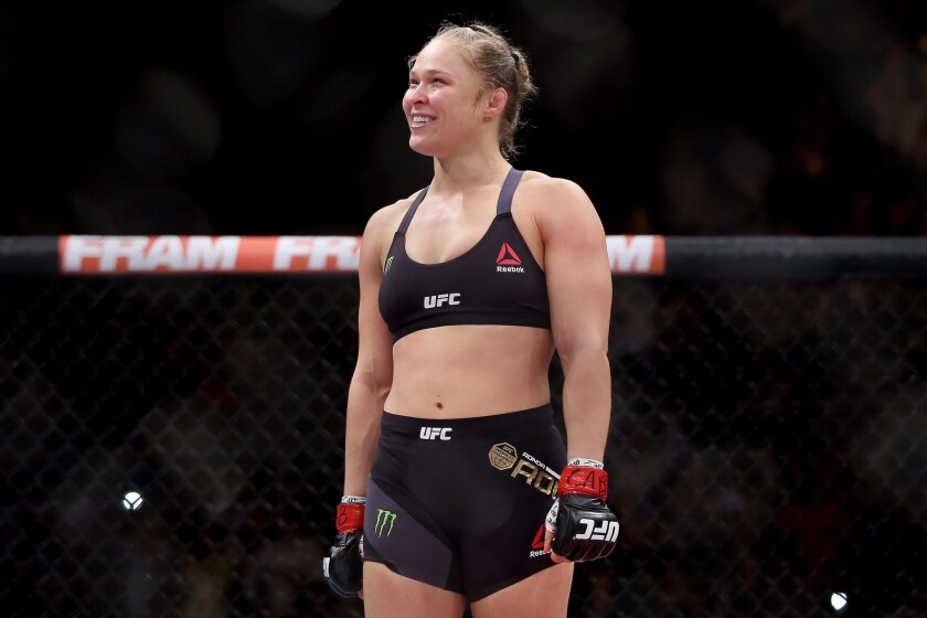Ronda Rousey enjoys the moment after defending her UFC bantamweight belt against Bethe Correia on Saturday night.