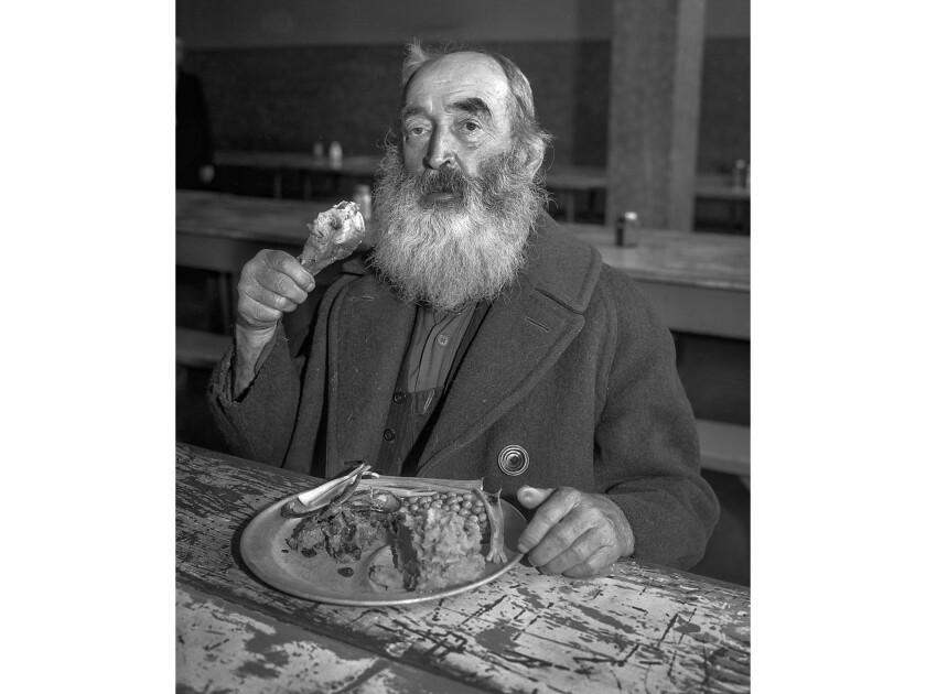 Nov. 28, 1935: John Carney enjoys Thanksgiving dinner at the Midnight Mission in Los Angeles.