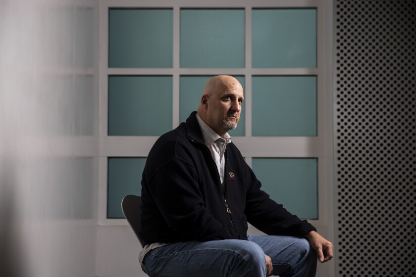Tim Zaal poses for a portrait at the Museum of Tolerance in Los Angeles. Zaal, a former neo-Nazi skinhead, speaks regularly at the museum to battle white supremacist ideals.