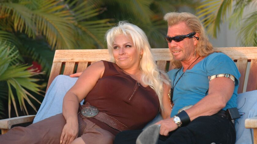 """Duane """"Dog"""" Chapman and his wife, Beth, sit in their back yard during a shoot for their A&E network"""