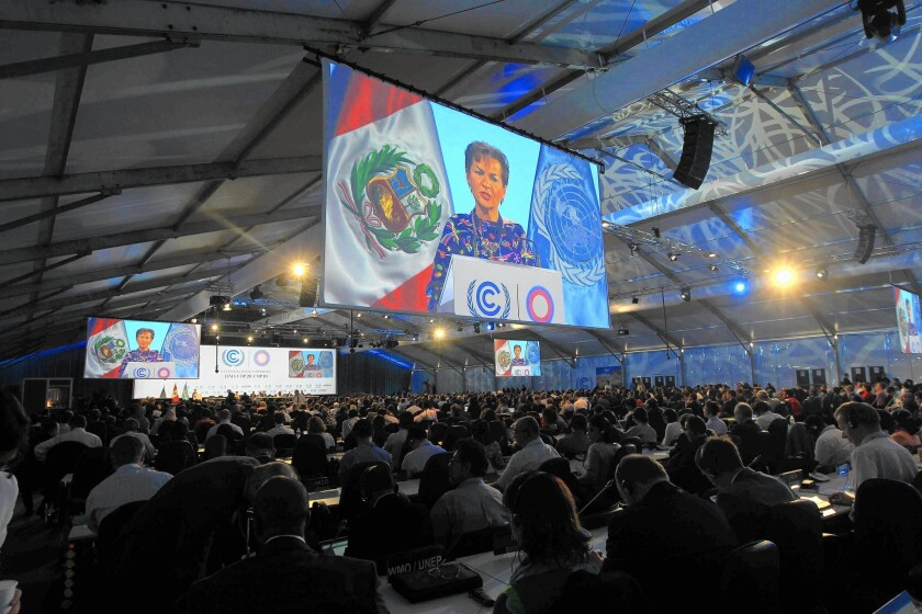 Christiana Figueres, who heads the United Nations Framework Convention on Climate Change, speaks at the gathering's opening in Lima, Peru.