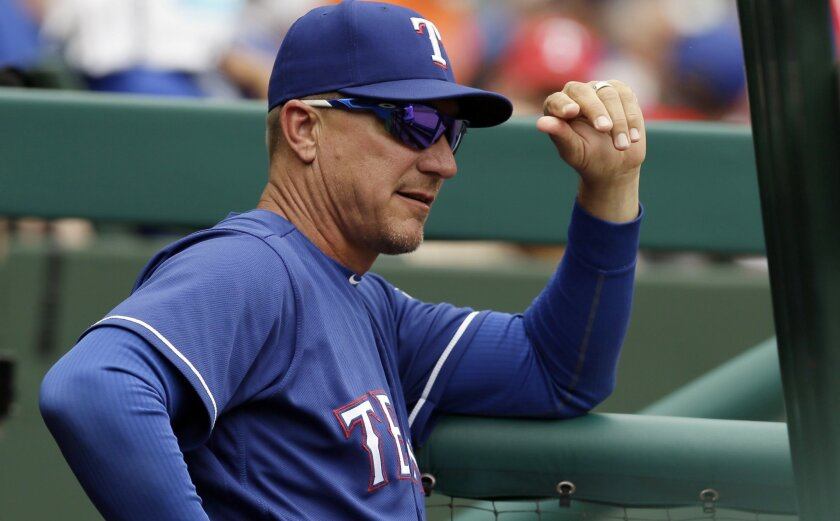 FILE - In this Wednesday, May 25, 2016, file photo, Texas Rangers manager Jeff Banister looks on from the dugout during a baseball game against the Los Angeles Angels in Arlington, Texas. Before leading the Rangers to the AL West title last season in his first as a manager, Banister spent 29 season