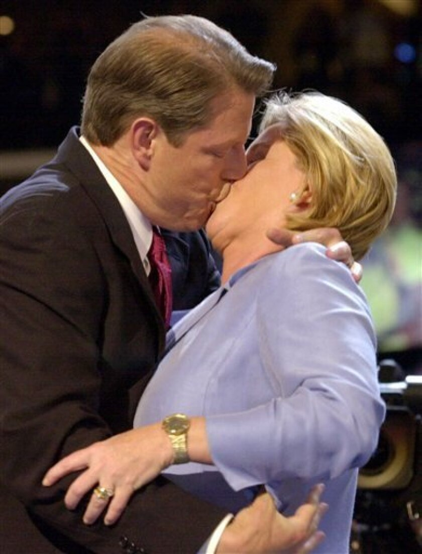 FILE - In this Aug. 17, 2000 file photo. then-Vice President Al Gore kisses his wife Tipper as he steps onto the stage at the Democratic National Convention in Los Angeles. Former Vice President Al Gore and his wife, Tipper, are separating after 40 years of marriage. (AP Photo/Stephen Savoia, File)