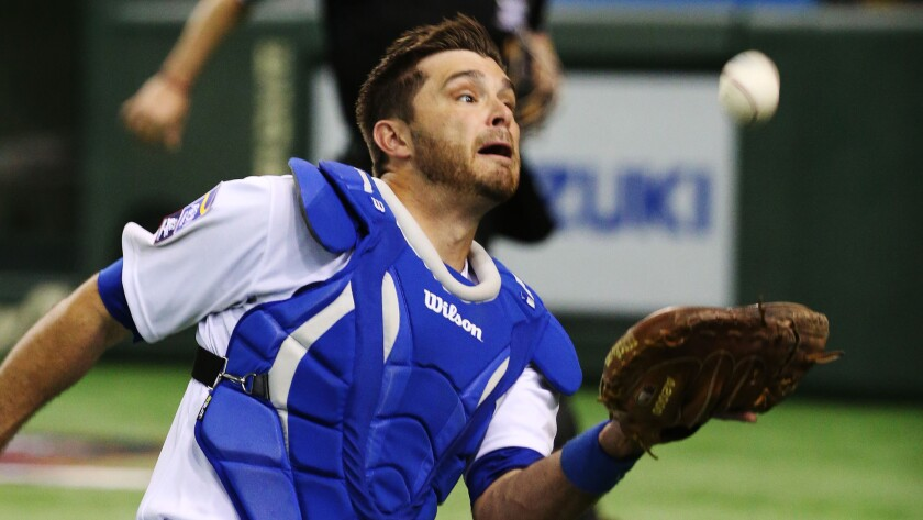 Dodgers catcher Drew Butera makes a catch during an exhibition game featuring MLB players in Tokyo on Nov. 16.