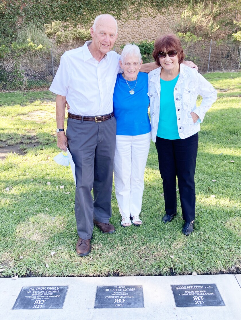 Plaque honorees Jim and Karen Sommer with plaque donor Kessy Schade at the Pathway of Pride ceremony on Oct. 30.