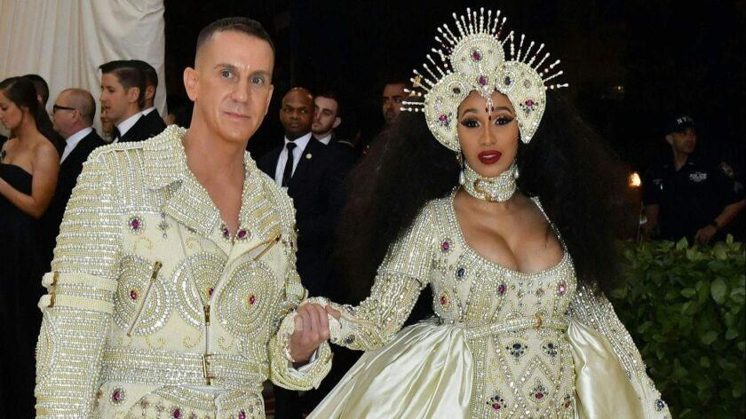 Jeremy Scott and Cardi B arrive at the 2018 Met Gala on Monday at the Metropolitan Museum of Art in New York. The annual gala raises money for the Metropolitan Museum of Art's Costume Institute.
