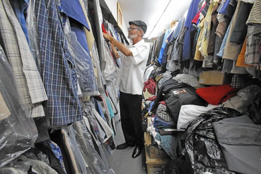 Greg Thorton browses the racks at Greenspan's, a family-owned vintage clothing store in South Gate.