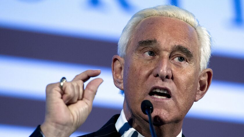 Roger Stone, shown speaking at the American Priority Conference in Washington on Dec. 6, was arrested Friday after being indicted on charges of lying to Congress.