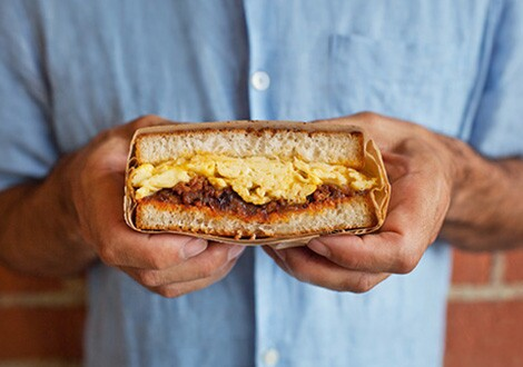 The chorizo and egg sandwich with caramelized onions at Sycamore Kitchen.