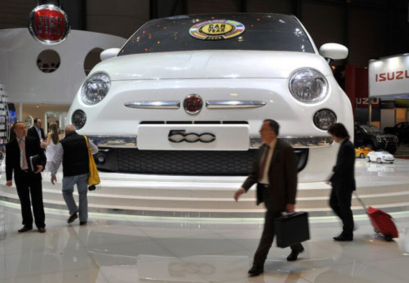 A Godzilla-sized Fiat 500 graces the exhibit hall at the Geneva Auto Show.