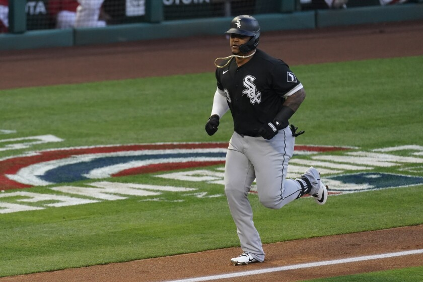 Chicago White Sox's Yermin Mercedes (73) runs the bases after hitting a home run during the second inning of a baseball game against the Los Angeles Angels Saturday, April 3, 2021, in Anaheim, Calif. (AP Photo/Ashley Landis)