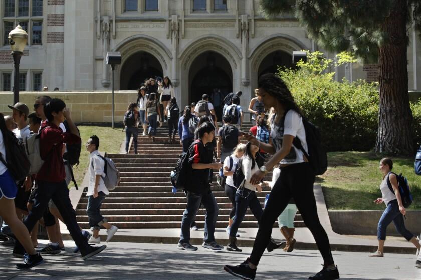Students walk along Bruin Walk on the UCLA campus.
