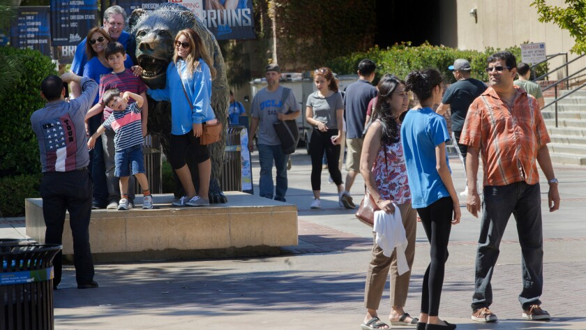 A group poses for a photo with UCLA's Bruin bear statue as students tour the campus with family members before the start of school in September.