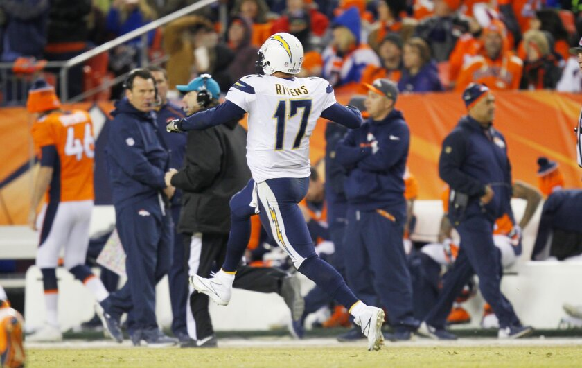 Chargers Philip Rivers celebrates a touchdown pass to Tyrell Williams against the Broncos in the 4th quarter.