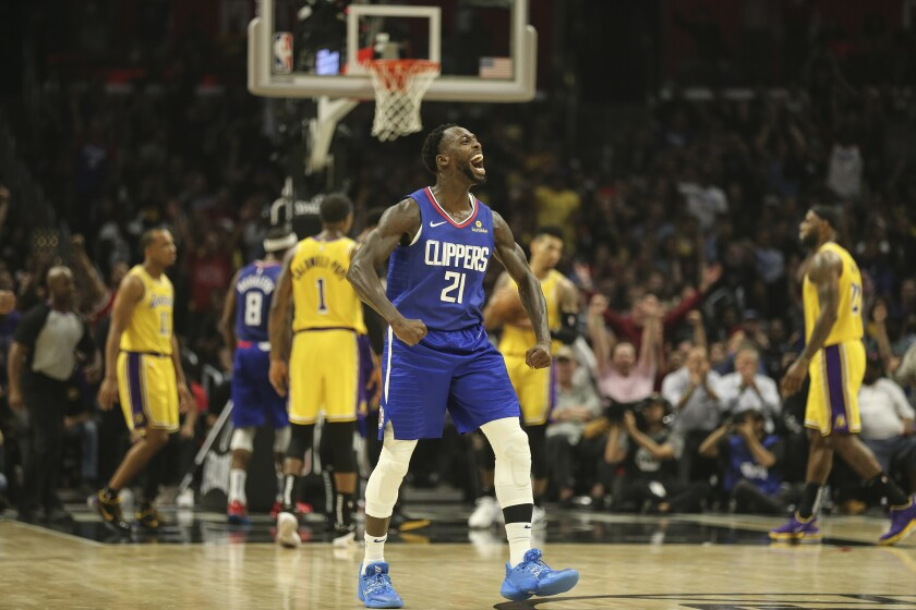Clippers guard Patrick Beverley (21) celebrates during the fourth quarter of a victory over the Lakers on Tuesday night.